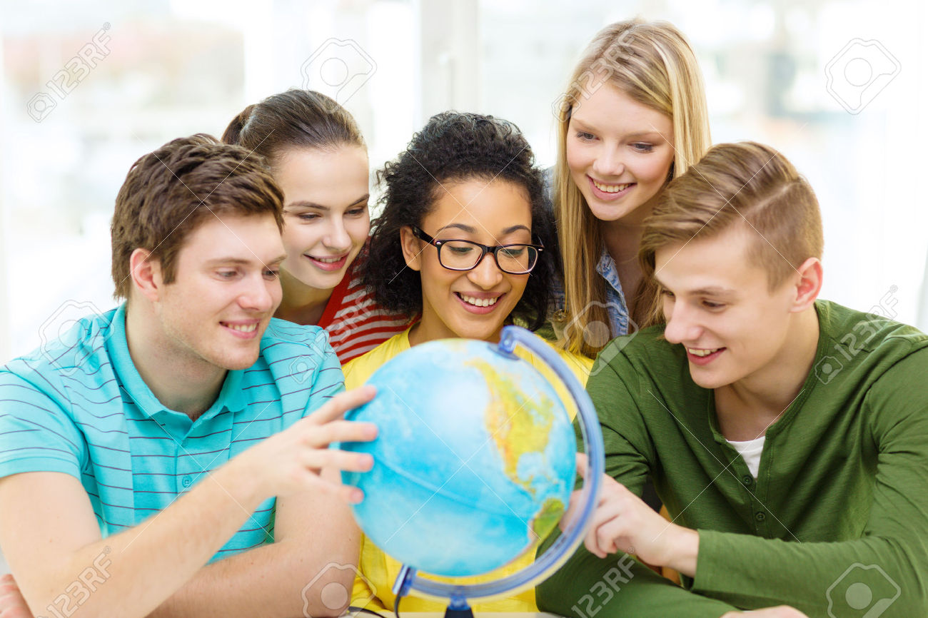 28781165-education-travel-and-geography-concept-five-smiling-student-looking-at-earth-globe-at-school-Stock-Photo